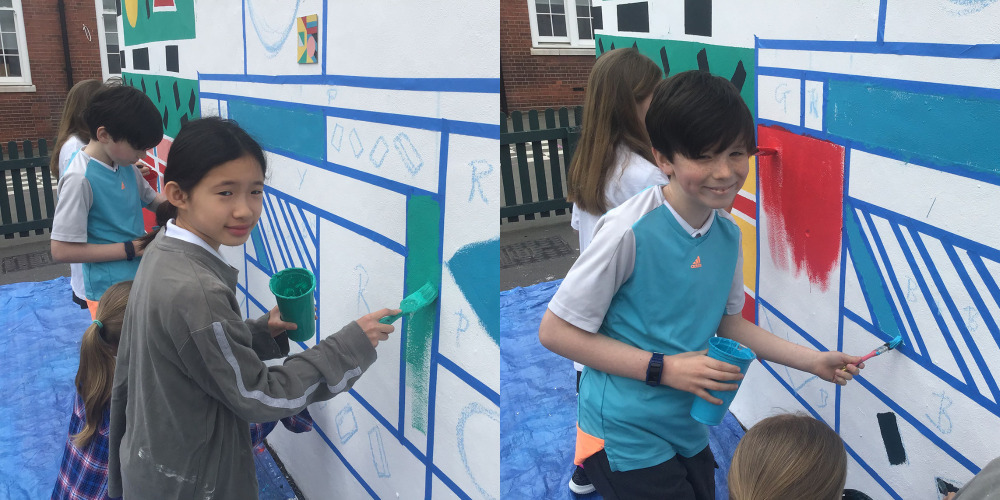 Adding the design to the school mural.