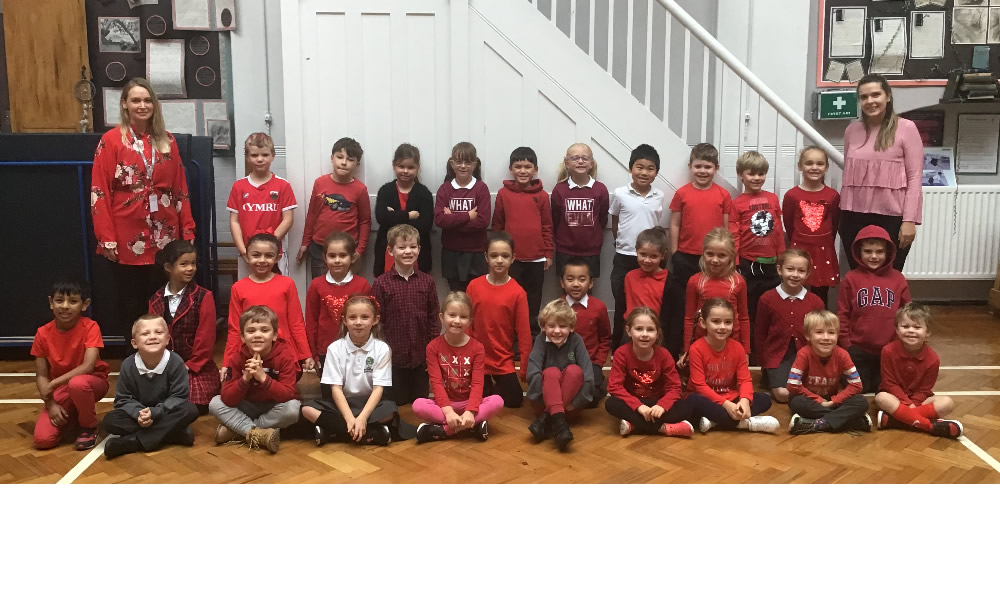 Showing support for 'Show racism the red card' on Wear Red Day.