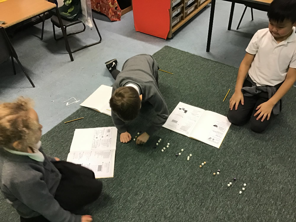 Using cubes for a division problem.