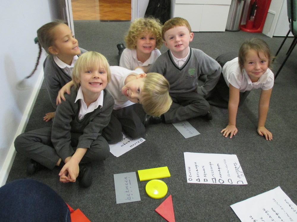 Working on shape and positional language in maths.