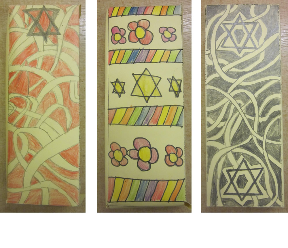 Jewish mezuzah cases for prayers or religious texts.