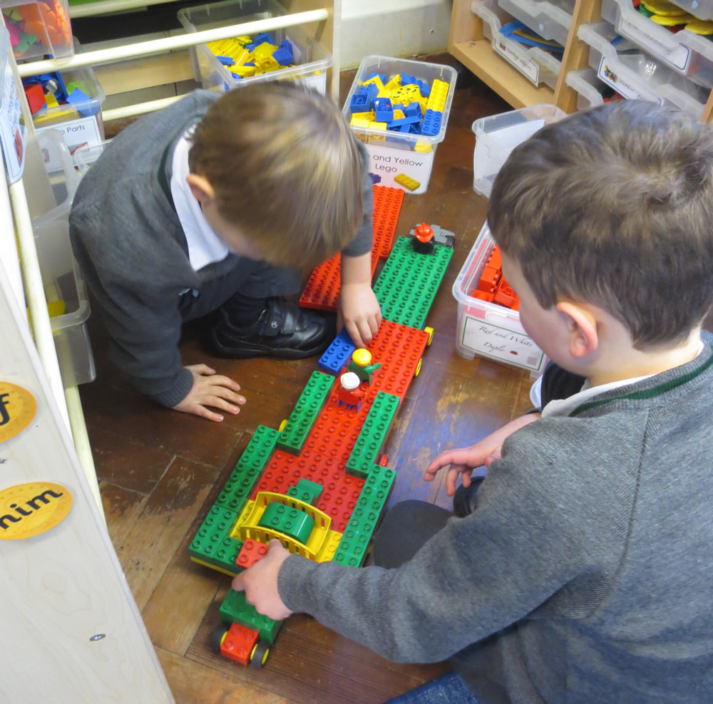 Working together on a Lego project.