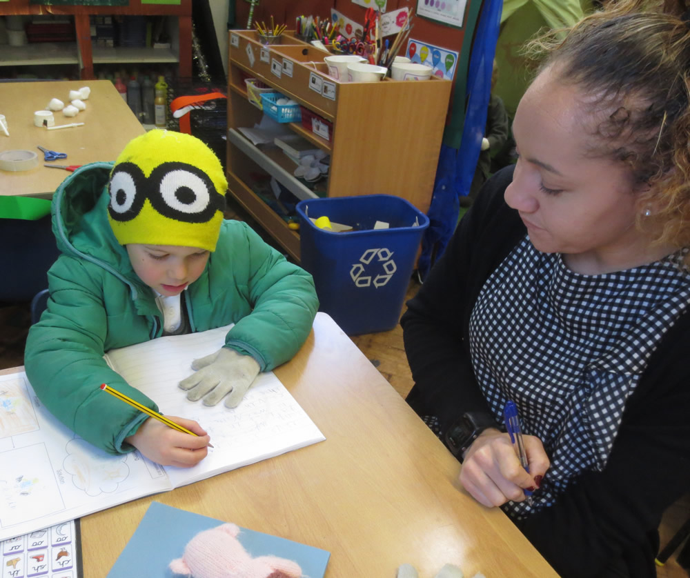 Just popped in from playing outside to help Miss Miller with some work.