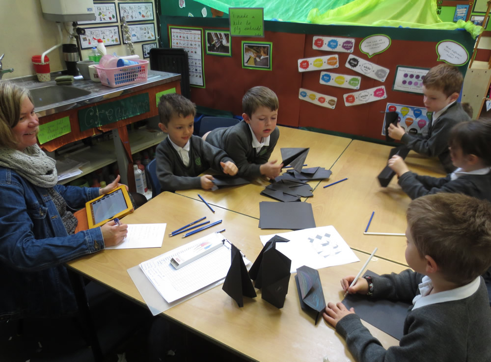 Folding paper penguins.