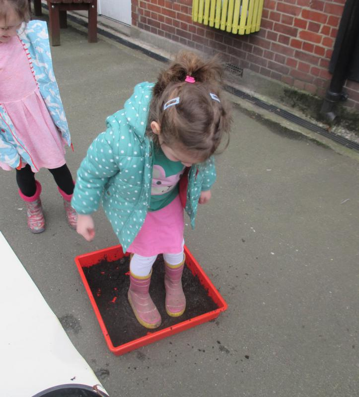 We found wellies with interesting patterns on the bottom and walked in the mud ...
