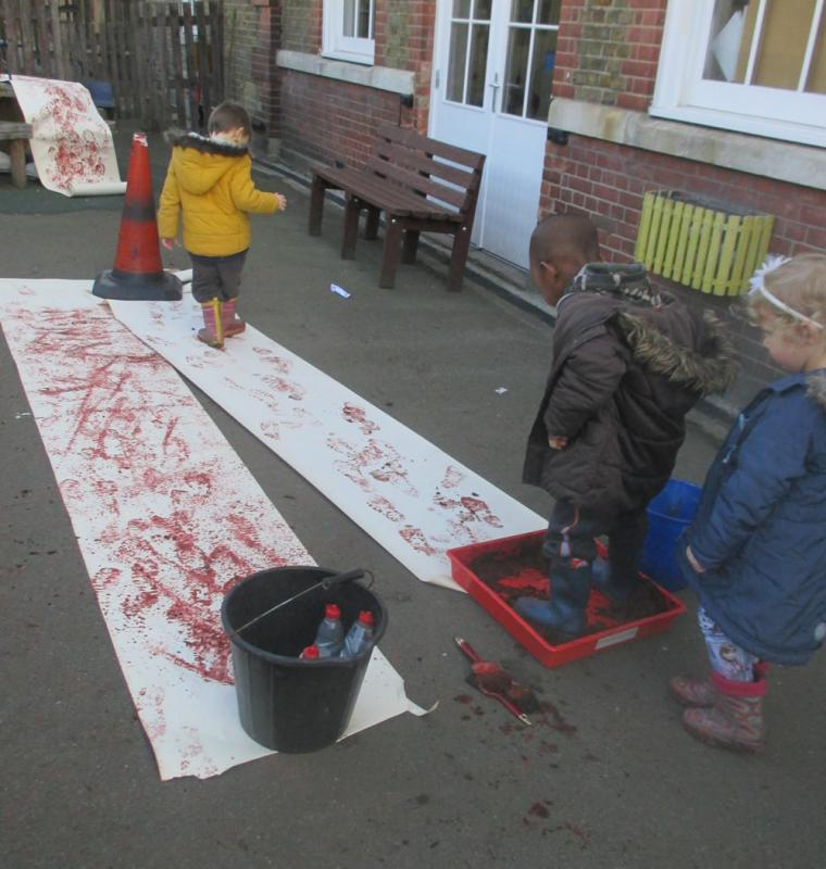 We had such good fun and made a special background for the Forest School display.