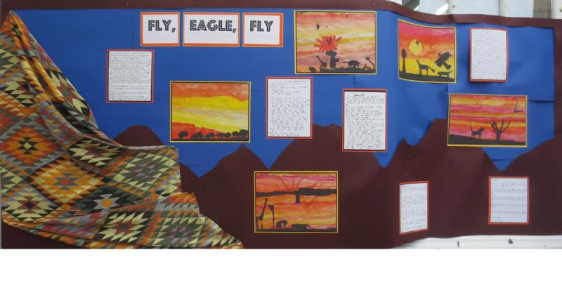 We wrote African stories of our own and put animal silhouettes on brightly coloured painted backgrounds.